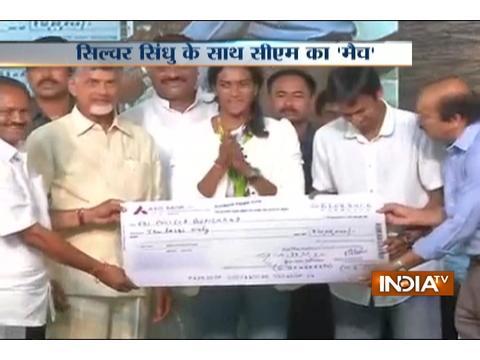 AP CM Naidu felicitates Olympic Silver Medalist PV Sindhu in Vijaywada