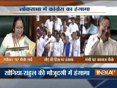 Congress create ruckus in the Lok Sabha after tearing & throwing paper on Speaker