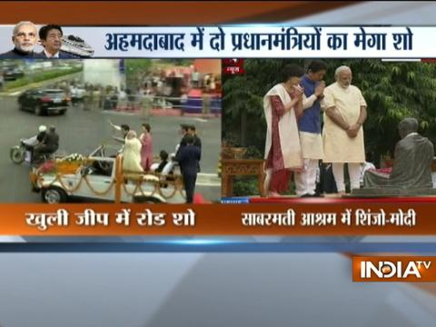 Japanese PM Shinzo Abe, PM Modi pay respects to Mahatma Gandhi at Sabarmati Ashram