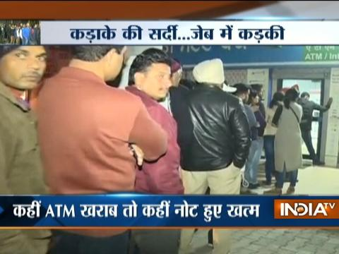 Note Ban: Public bears it all, queue-up outside ATM in severe cold condition