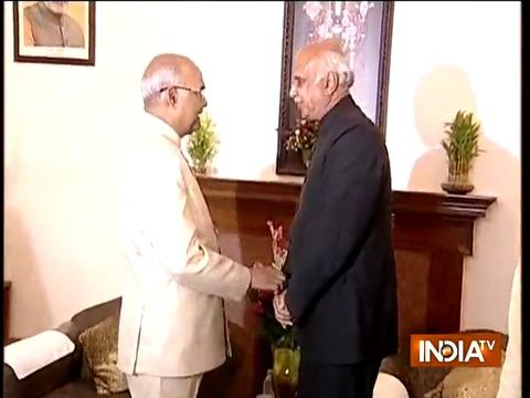 Returning Officer Anoop Mishra congratulates Ram Nath Kovind