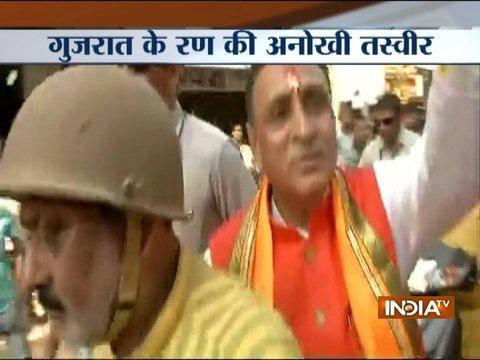 Gujarat CM Vijay Rupani takes scooty to visit temple amidst huge crowd
