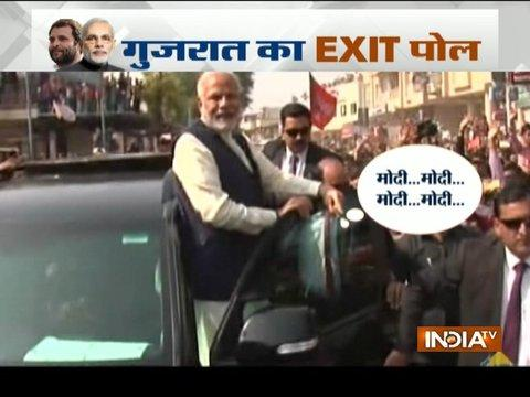 Public chant 'Modi-Modi' as he greets people after casting his vote in Ahmedabad