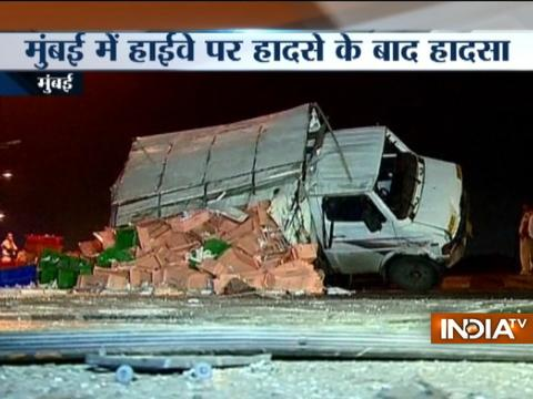Vehicles collide while watching an over turned truck on a highway in Mumbai