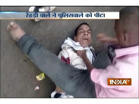 Vendor in Madhya Pradesh publicly thrashes policeman for not paying him