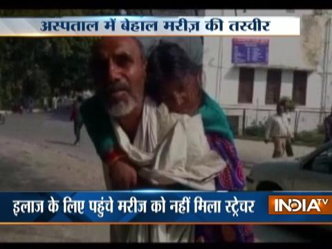 Denied hospital stretcher,Kanpur man carries ailing wife on shoulders