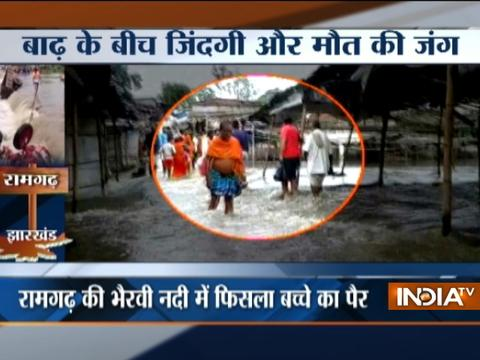 Monsoon 2017: Watch how Kid rescued from floodwaters in Jharkhand