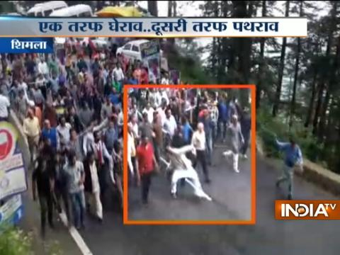 BJP Counsellor caught pelting stones on cars with mob in Shimla