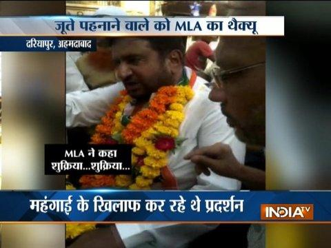 Ahemdabad Congress MLA garlanded with shoes during a rally