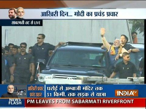 Gujarat Election 2017: PM Modi waves to the crowd at Ahmedabad's Sabarmati Riverfront