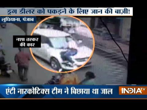 Cop jumps on car bonnet to catch drug Smuggler in Ludhiana
