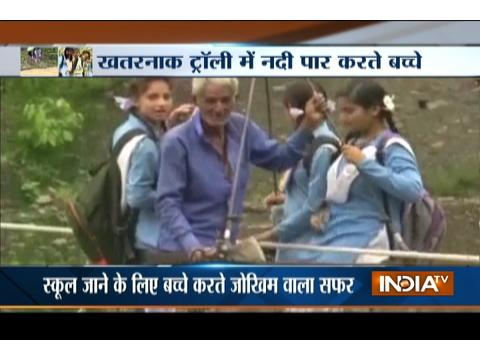 Children risk their lives crossing river by cable trolley in Uttrakhand