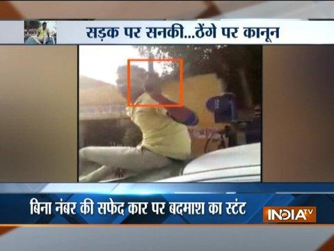 Man brandishes wepaon as drives through Allahabad road