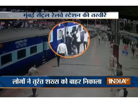 Man escapes death after falling off a moving local train in Mumbai