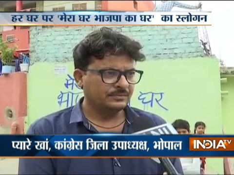 MP: BJP workers write party slogan outside houses in Bhopal