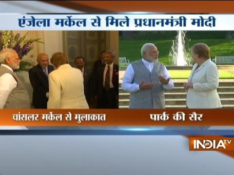 PM Modi and German Chancellor Angela Merkel interact at Schloss Meseberg's garden in Germany
