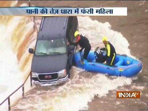 America: Woman rescued after getting trapped in flooded waterfall