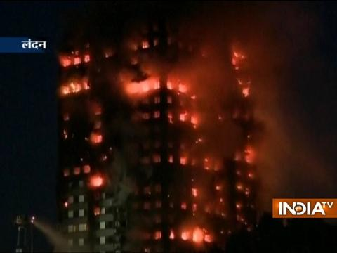 Fire engulfs 24-storey tower block in Latimer Road, West London