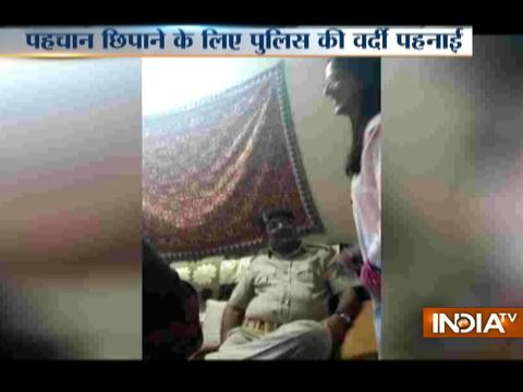 Ahmedabad Police cover bizman Mahesh Shah with the Police uniform