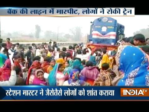 People block railway tracks in UP's Kushinagar on returning empty-handed from