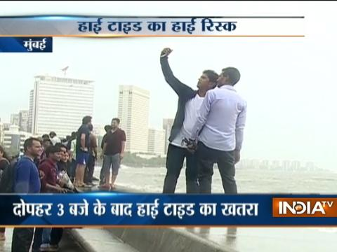 Youths continue to take selfies near Marine Drive despite high tide warning issued by MeT