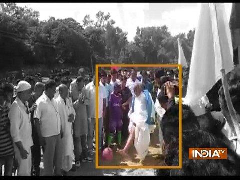 Bihar Minister falls down while kicking football during a tournament in Nalanda