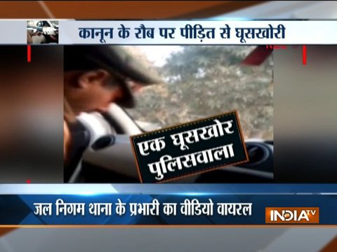 Cop caught on camera taking bribe in Ghaziabad