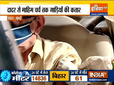 मुंबई में कार में बैठे-बैठे कोरोना का टीका लगाना शुरू