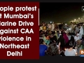 People protest at Mumbai's Marine Drive against CAA violence in Northeast Delhi