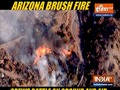 Arizona brush fire: Crews battle on ground and air