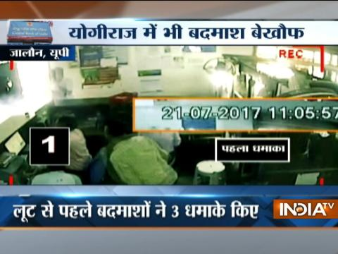 Masked men blast bombs, loot Rs 5.50 lakh cash from a bank in Jalaun
