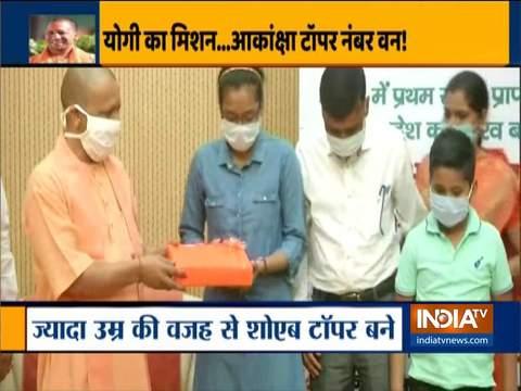 Uttar Pradesh: Yogi Adityanath felicitates NEET topper Akanksha Singh