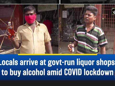 Locals arrive at govt-run liquor shops to buy alcohol amid COVID lockdown