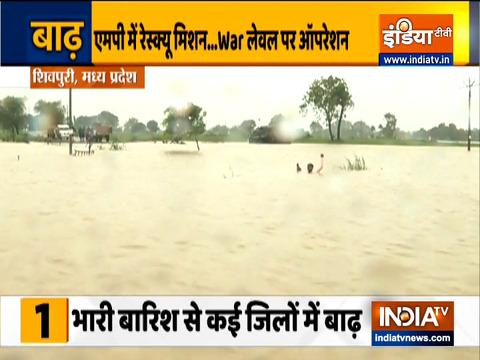 देश के कुछ हिस्सों में भारी बारिश से बाढ़, भूस्खलन; बचाव कार्य में एनडीआरएफ तैनात
