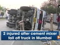 2 injured after cement mixer fall off truck in Mumbai