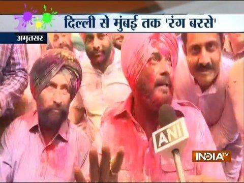 UP CM Yogi Adityanath, Congress MP Navjot Singh Sidhu celebrate Holi