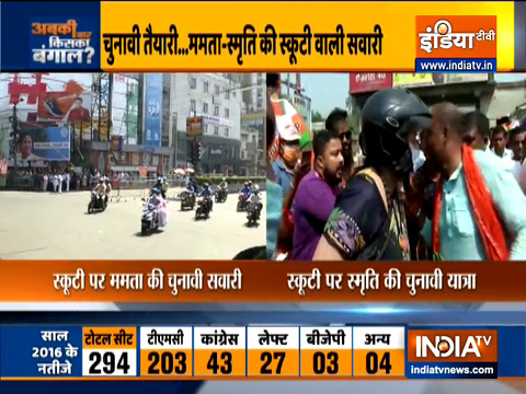 After Mamata Banerjee, BJP leader Smriti Irani rides a scooty today in Bengal