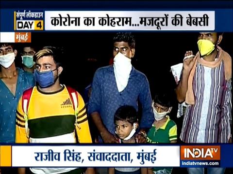 Coronavirus: मुंबई पुलिस ने लॉकडाउन के बीच हाईवे पर प्रवासियों को रोका