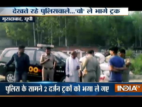 UP Crime: Mining Mafia flees with trucks of sand infront of police in Moradabad