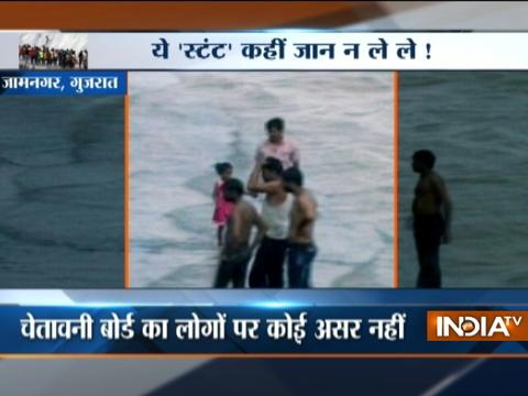 Youths spotted performing deadly stunt near dam at Jamnagar, Gujarat