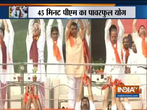 Cabinet Minister Nitin Gadkari performs yoga in Nagpur on International Yoga Day