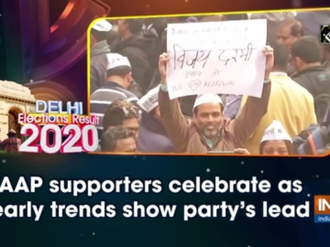 Delhi election results: AAP supporters celebrate as early trends show party's lead