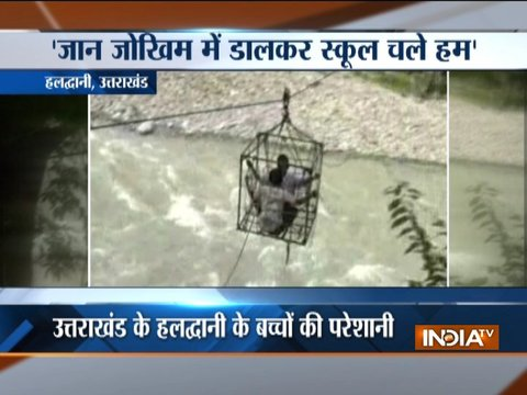 School kids cross river with trolley in Uttarakhand's Haldwani