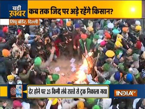 Farmers protesting at Singhu Border burn copies of the Farm Laws to celebrate Lohri