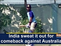 India sweat it out for comeback against Australia