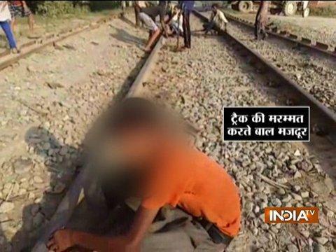 Child labours spotted repairing railway tracks at Rampur, UP