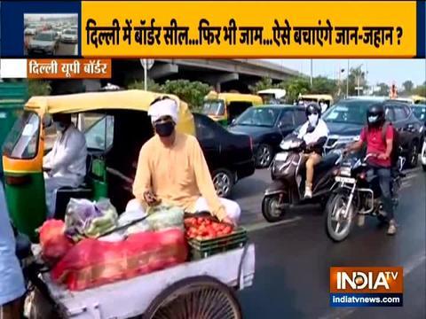 दिल्ली-नोएडा बॉर्डर सील होने के कारण सड़क पर लगा भारी ट्रैफिक जाम