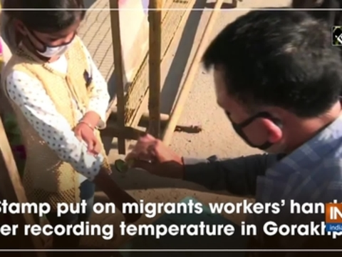 Stamp put on migrants workers' hands after recording temperature in Gorakhpur
