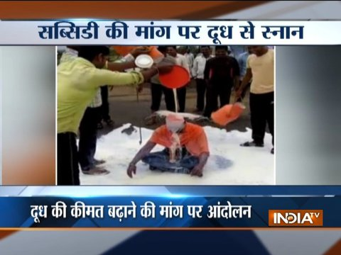 Maharashtra dairy farmers spilling milk on roads as a part of protest