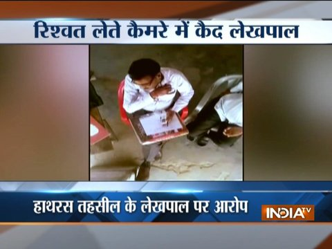 Uttar Pradesh: Govt officer caught on camera taking bribe from a farmer in Hathras